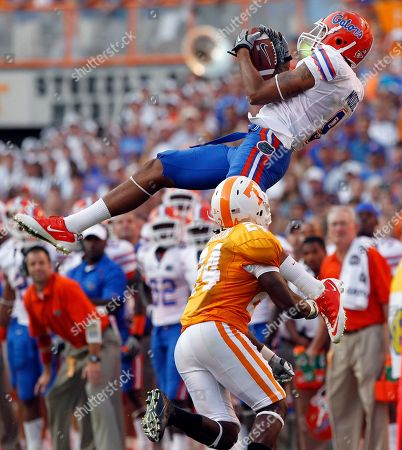 Carl Moore, Eric Gordon. Florida wide receiver Carl Moore (9) hangs on to a pass as he is defended by Tennessee cornerback Eric Gordon (24) in the fourth quarter of an NCAA college football game, in Knoxville, Tenn. Florida won 31-17