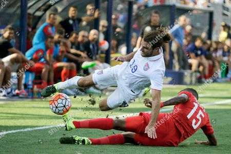 Erick Davis, Graham Zusi. United States' Graham Zusi (19) is tripped up by Panama's Erick Davis (15) during the first half of the CONCACAF Gold Cup third place soccer match, in Chester, Pa