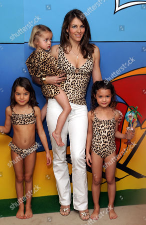 Liz Hurley Unveils Her Latest Swimwear Collection. Pebble Adams Aged 3 And Elizabeth Hurley. (front Row L To R) Blake Forest Aged 8 And Hanaya Merlet Aged 6 At The Launch Of Hurley's New Beach Kids Collection At Harrods In West London. But Critics Have Argued That Leopardskin Is Simply Too Grown-up For Children. Elizabeth Hurley Launches The Elizabeth Hurley Beach Kids Collection At Harrods . The Elizabeth Hurley Beach Kids Collection Mirrors Everything In The Adult Range Including Bikinis Swimsuits And Kaftans - The Age Range Is From 2-10 And Prices Range From 25 - 57 . The Models Are Sophia Puncocharova(back) And The Children From Left Are; Blake Forrest Age 8 Hannah Merlet Age 6 And Pebble Adams Age 3.