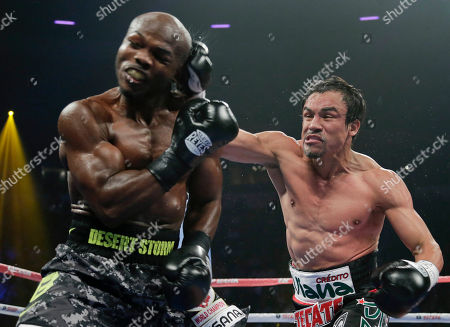 Juan Manuel Marquez, Timothy Bradley. Juan Manuel Marquez, right, lands a punch against Timothy Bradley in the third round during a WBO welterweight title fight, in Las Vegas. Bradley won by split decision