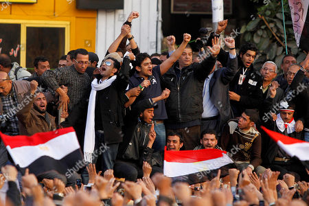 """Egyptian Wael Ghonim, center, a 30-year-old Google Inc. marketing manager who was a key organizer of the online campaign that sparked the first protest on Jan. 25, talks to the crowd in Tahrir Square, in Cairo, Egypt, . A young leader of Egypt's anti-government protesters, newly released from detention, joined a massive crowd of hundreds of thousands in Cairo's Tahrir Square for the first time Tuesday, greeted by cheers, whistling and thunderous applause when he declared: """"We will not abandon our demand and that is the departure of the regime"""
