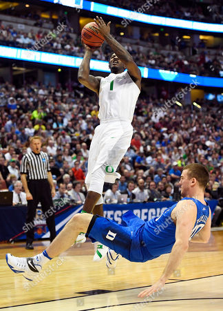 Oregon forward Jordan Bell shoots over Duke center Marshall Plumlee during the first half of an NCAA college basketball game in the regional semifinals of the NCAA Tournament, in Anaheim, Calif