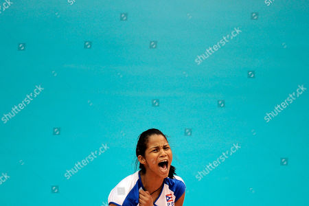 Puerto Rico's Diana Reyes celebrates after winning a women's volleyball match against Peru at the Pan American Games in Guadalajara, Mexico
