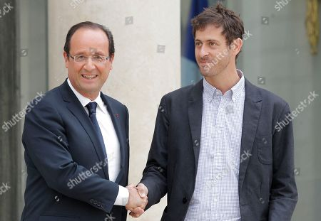 French President Francois Hollande shakes hands with journalist Romeo Langlois recently freed by Colombian rebels after their meeting at the Elysee Palace in Paris . The 35-year-old journalist was accompanying Colombian soldiers on a cocaine-lab destruction mission on April 28 when rebels attacked