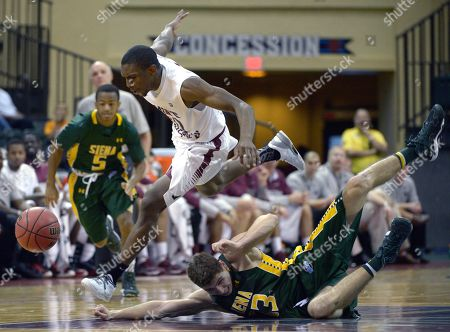 Langston Galloway, Rob Poole, Evan Hymes. Saint Joseph's guard Langston Galloway, center, steals the ball from Siena guard Rob Poole, below, as Evan Hymes watches during the first half of an NCAA college basketball game at the Old Spice Classic tournament in Kissimmee, Fla