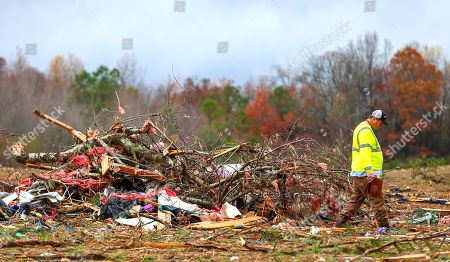 Stock Photo of Bob Wright looks for personal belongings after a suspected tornado ripped through the town of Rosalie, killing three of his brother's family members, in Rosalie, Ala