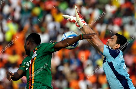 Tunisia's goalkeeper Aymen Mathlouthi, right, is challenged by Zambia's Emmanuel Mayuka, left, during their African Cup of Nations Group B soccer match in Ebibeyin, Equatorial Guinea