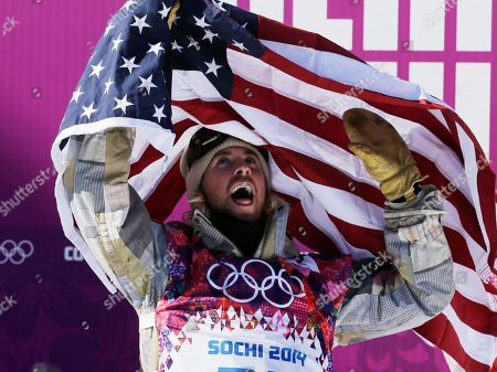 United States' Sage Kotsenburg celebrates after winning the men's snowboard slopestyle final at the Rosa Khutor Extreme Park, at the 2014 Winter Olympics, in Krasnaya Polyana, Russia