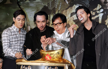 "Jackie Chan, John Cusack, Adrien Brody, Siwon Choi. U.S. actor Adrien Brody, from right, Hong Kong actor Jackie Chan, U.S. actor John Cusack and South Korean actor Siwon Choi taste dumplings during an event to promote their new movie ""Dragon Blade"" in Taipei, Taiwan"