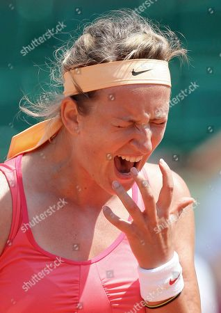 Belarus' Victoria Azarenka reacts shortly before defeating Italy's Alberta Brianti during their first round match in the French Open tennis tournament at the Roland Garros stadium in Paris, Monday, May, 28, 2012. Azarenka won 6-7, 6-4, 6-2