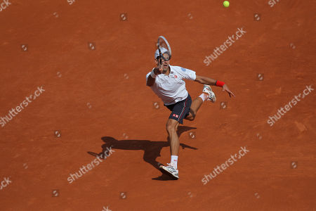 Novak Djokovic of Serbia returns in his first round match against Potito Starace of Italy at the French Open tennis tournament in Roland Garros stadium in Paris