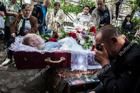 Stock Image of A man cries during the funeral of Alexey Vorobyov, a civilian killed by Ukraine National Guard during an operation against pro Russian activist last Friday in Mariupol, Ukraine, . Pro-Russia insurgents in eastern Ukraine declared independence Monday, a day after holding a hastily arranged referendum vote on separatism that Ukraine's government and its western allies said violated international law