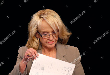 Gov. Jan Brewer looks over official's election results at an event at the Arizona Capitol, in Phoenix. Brewer and her staff are working on a state budget proposal for the coming year that will protect her key priorities in the face of a projected budget shortfall