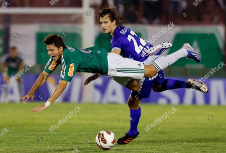 Kleber, Lucas Orban. Brazil's Palmeiras' Kleber, front, falls after being tackled by Argentina's Tigre's Lucas Orban during a Copa Libertadores soccer match in Buenos Aires, Argentina