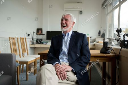 """Joint winner of the Nobel Prize for Physiology or Medicine professor John O'Keefe, a dual U.S. and British citizen, laughs as he is interviewed by The Associated Press in an office he uses at the University College London (UCL), in London, . The U.S.-British scientist and a Norwegian husband-and-wife research team won the Nobel Prize in medicine Monday for discovering the brain's navigation system - the inner GPS that helps us find our way in the world - a revelation that one day could help those with Alzheimer's. The research by John O'Keefe, May-Britt Moser and Edvard Moser represents a """"paradigm shift"""" in neuroscience that could help researchers understand the sometimes severe spatial memory loss associated with Alzheimer's disease, the Nobel Assembly said"""
