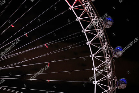 """Stock Image of Dancers perform on the London Eye in London as part of London 2012 Olympic Festival, . The performances """"Surprises : Streb"""" choreographed by New Yorker Elizabeth Streb take place on various London's landmarks"""