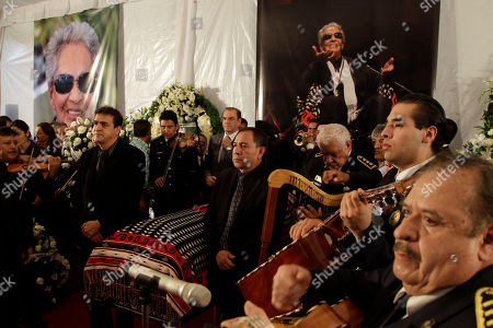 Mariachi musicians perform as city officials stand at honor guard next to the coffin of famed Mexican singer Chavela Vargas during a homage at the traditional Mariachi Garibaldi Plaza in Mexico City, . Chavela Vargas, who defied gender stereotypes to become one of the most legendary singers in Mexico, died Aug. 5 at age 93