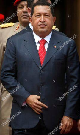 Venezuela's President Hugo Chavez looks on during a welcoming for Abkhazia's President Sergei Bagapsh and South Ossetia's President Eduard Kokoity at Miraflores presidential palace in Caracas, Venezuela