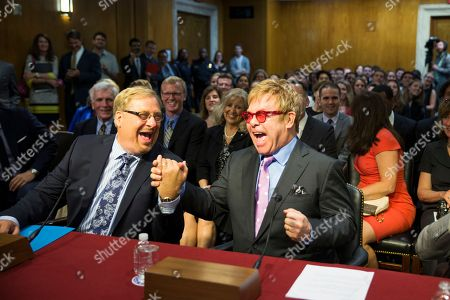 Elton John, Rick Warren. Musician Sir Elton John, right, greets Dr. Rick Warren on Capitol Hill in Washington, prior to testifying before the Senate State, Foreign Operations, and Related Programs subcommittee in support of U.S. funding for global HIV/AIDS treatment