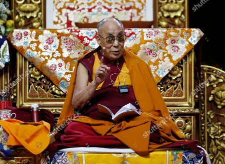 The Dalai Lama Tenzin Gyatso delivers his message as he attends a fair, in Milan, Italy, . The Dalai Lama received honorary citizenship from the city of Milan