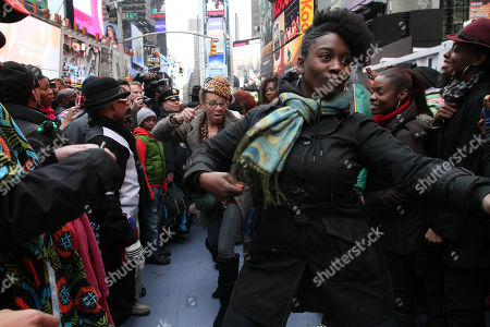 """Participants of a """"Soul Train"""" line flash mob make their way along the line during a tribute to """"Soul Train"""" creator Don Cornelius in New York's Times Square"""