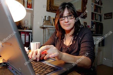 Editorial picture of Kate Figes At Her Home In Stoke Newington Where She Became Ill After Installing A Wi-fi Wireless Computer Network. She Contacted Campaign Group Electrosensitivityuk Who Advise Parents Not To Install Wi-fi In Order To Protect The Health Of Their Child