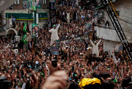 Supporters of Pakistan Muslim League-N party cheer their leader Mian Nawaz Sharif, not pictured, during an election campaign rally in Murree, some 58 kilometers (36 miles) northeast from Islamabad, Pakistan, . Pakistan is scheduled to hold parliamentary elections on May 11, the first transition between democratically elected governments in a country that has experienced three military coups and constant political instability since its creation in 1947
