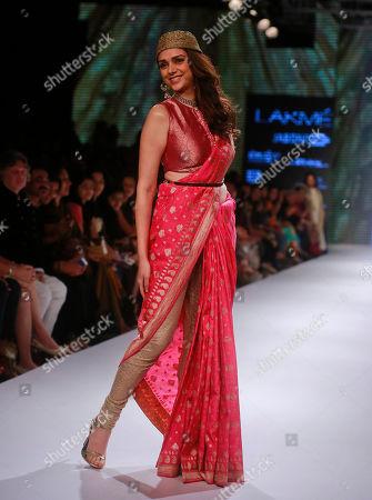 Bollywood actress Aditi Rao Hydari displays a creation of designer Ritu Kumar during the Lakme Fashion Week in Mumbai, India