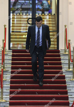 Irish Minister for Finance Brian Lenihan arrives with a copy of the Budget 2011 at Government Buildings, Dublin, Ireland, . Debt-struck Ireland braced for the painful details Tuesday of the toughest budget in its history, a condition for receiving a massive international bailout