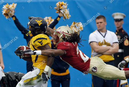 Noel Devine, Patrick Robinson. West Virginia running back Noel Devine runs for a second-quarter touchdown as Florida State cornerback Patrick Robinson attempts to make the tackle during the Gator Bowl NCAA college football game, in Jacksonville, Fla