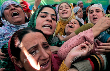 Relatives cry during the funeral procession of Haji Syed Mohammad Yousuf, a 61-year-old retired teacher and worker of the governing National Conference party in Indian-controlled Kashmir, in Locktipora, some 55 Kilometers (34 miles) south of Srinagar, India, . Yousuf died in police custody Friday after the disputed region's top elected official handed him over to investigators for probing charges that he took money from people promising to get them nominated as lawmakers, according to news reports