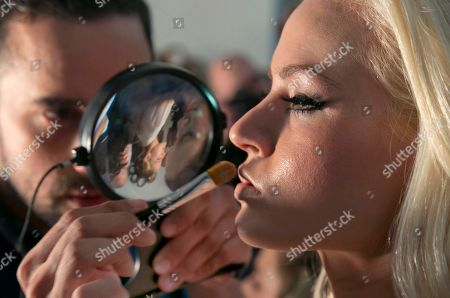 """Model Gia Genevieve has her make-up applied backstage before the 2015 CURVExpo and Invista sleepwear, loungewear and swim collections are modeled, during the 2nd annual Lingerie Fashion Night, """"Romancing the Runway,"""" in New York"""