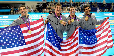 Michael PhelpsConor Dwyer, Ricky Berens, Ryan Lochte. From left, United States' Michael Phelps, United States' Conor Dwyer, United States' Ricky Berens and United States' Ryan Lochte pose with their gold medals for the men's 4x200-meter freestyle relay swimming final at the Aquatics Centre in the Olympic Park during the 2012 Summer Olympics in London