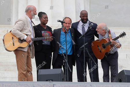 Sybrina Fulton, Tracy Martin, Peter Yarrow, Paul Stookey, Mark Barden. With Trayvon Martin parents, Sybrina Fulton, and Tracy Martin, and Mark Barden, father of Sandy Hook Elementary School shooting victim Daniel Barden, Peter Yarrow, left, and Paul Stookey, right, of the folk trio Peter, Paul and Mary, perform at the 50th Anniversary of the March on Washington where Martin Luther King, Jr., spoke, in front of the Lincoln Memorial in Washington