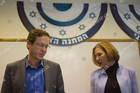 Isaac Hezcog, Tzipi Livni. Zionist Union party co-leaders Isaac Hezcog and Tzipi Livni arrive to deliver a statement in the party's election headquarters in Tel Aviv, Israel, a day after Israel held legislative election. Netanyahu's right-wing Likud Party scored a resounding victory in Israel's election, final results showed Wednesday, a stunning turnaround after a tight race that had put his lengthy rule in jeopardy