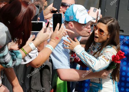 Stock Image of Danica Patrick,Taylor Bright. Taylor Bright, of Clemson S.C., tries to kiss Danica Patrick (10) during driver introductions for the NASCAR Sprint Cup Series auto race at Martinsville Speedway in Martinsville, Va., . Bright also gave Patrick flowers and a ring while proposing