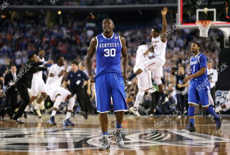 Kentucky forward Julius Randle (30) walks off the court after his team's 60-54 loss to Connecticut in the NCAA Final Four tournament college basketball championship game, in Arlington, Texas