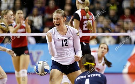 Penn State's Micha Hancock (12) reacts after she blocked a shot by Wisconsin in an NCAA women's volleyball tournament championship final, in Seattle. Penn State won in four games