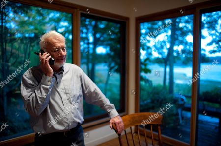 Chemistry Nobel Prize winner Thomas A. Steitz speaks on the phone at his home in Branford, Conn. . Two Americans and an Israeli scientist won the 2009 Nobel Prize in chemistry on Wednesday for atom-by-atom mapping of the protein-making factories within cells _ a feat that has spurred the development of antibiotics. The Royal Swedish Academy of Sciences said Venkatraman Ramakrishnan, Thomas Steitz and Israeli Ada Yonath's work on ribosomes has been fundamental to the scientific understanding of life