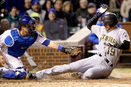 Chris Stewart,Miguel Montero. Pittsburgh Pirates' Chris Stewart, right, scores on a single hit by Jordy Mercer as Chicago Cubs catcher Miguel Montero applies a late tag during the sixth inning of a baseball game in Chicago