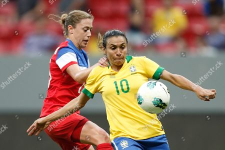 Marta Vieira, Christie Rampone. Brazil's Marta Vieira, right, fights for the ball with United States' Christie Rampone, during a match of the International Women's Football Tournament at the National Stadium in Brasilia, Brazil