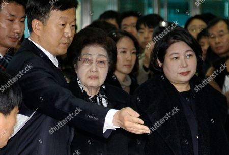 Lee Hee-ho, Hyun Jeong-eun. Lee Hee-ho, wearing glasses, widow of late former South Korean President Kim Dae-jung, and Hyundai Group chairwoman Hyun Jeong-eun, right, prepare to depart from the Inter-Korean Transit Terminal en route to North Korea from the border village of Paju in the demilitarized zone (DMZ), South Korea, . Lee and Hyun are part of a 18 person group allowed by South Korea to attend the Dec. 28 funeral of late North Korean leader Kim Jong Il in Pyongyang, North Korea