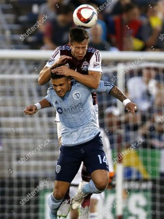 Sean St. Ledger, Dom Dwyer. Colorado Rapids defender Sean St. Ledger, top, climbs over Sporting Kansas City forward Dom Dwyer to head the ball in the first half of an MLS soccer match in Commerce City, Colo