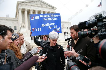 Former Health and Human Services Secretary Kathleen Sebelius speaks with reporters outside the Supreme Court in Washington, . The Supreme Court heard arguments in King v. Burwell, a major test of President Barack Obama's health overhaul which, if successful, could halt health care premium subsidies in all the states where the federal government runs the insurance marketplaces