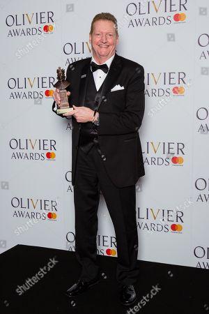 Stock Photo of Howell Binkley accepts the award for Best Lighting Design