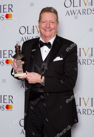 Stock Picture of Howell Binkley accepts the award for Best Lighting Design