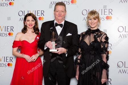 Howell Binkley accepts the award for Best Lighting Design, presented by Ophelia Lovibond and Hannah Arterton