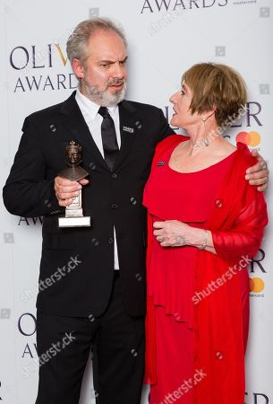 Sam Mendes accepts the award for Best Director, presented by Patti Lupone
