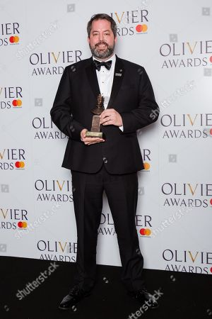 Benjamin Pearcy accepts the award for Best Set Design on behalf of Bob Crowley