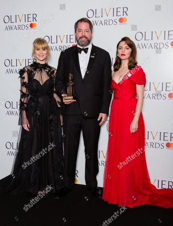 Benjamin Pearcy accepts the award for Best Set Design on behalf of Bob Crowley, presented by Ophelia Lovibond and Hannah Arterton